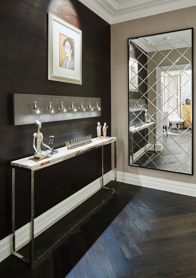 Mirrored walls enhance room scale interior